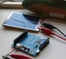 Solar powered arduino on the back of a playing card