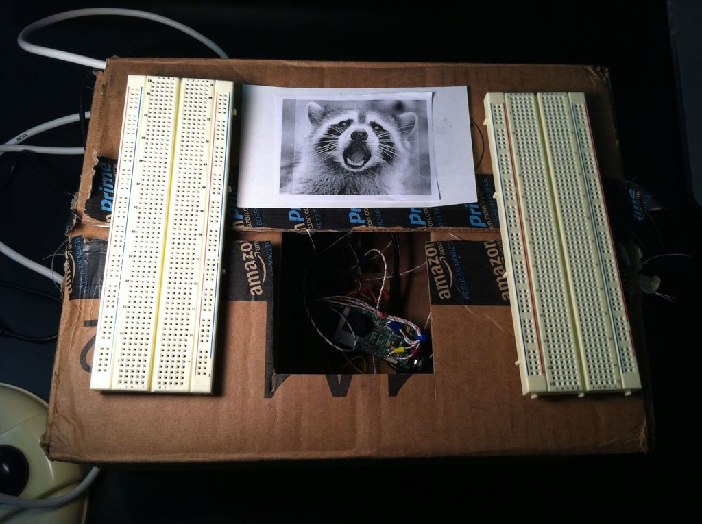 Motion Sensing Digital Camera & Alarm using Arduino