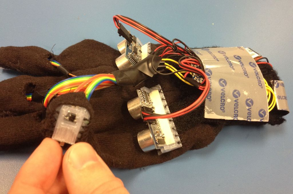 A Glove for the Blind to Feel Shapes and Navigate Obstacles