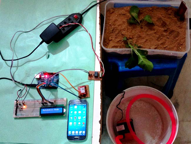 Whenever we go out of town for few days, we always used to worry about our plants as they need water on regular basis. So here we are making Automatic Plant Irrigation System using Arduino, which automatically provides water to your plants and keep you updated by sending message to your cell phone.  In This Plant Watering System, Soil Moisture Sensor checks the moisture level in the soil and if moisture level is low then Arduino switches On a water pump to provide water to the plant. Water pump gets automatically off when system finds enough moisture in the soil. Whenever system switched On or off the pump, a message is sent to the user via GSM module, updating the status of water pump and soil moisture. This system is very useful in Farms, gardens, home etc. This system is completely automated and there is no need for any human intervention.