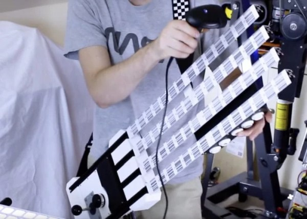 Barcode-scanner-MIDI-guitar-made-using-Arduino-and-acrade-machine-parts